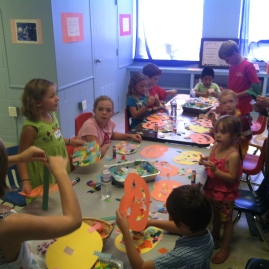 The Rev. Carol Kniesley leads crafts for the children